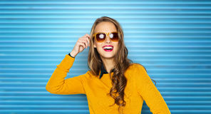 Happy young woman or teen girl in sunglasses Stock Images