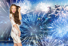 Happy young woman or teen over firework at city Royalty Free Stock Image