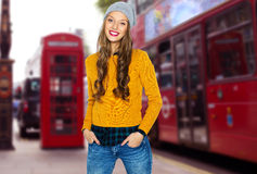 Happy young woman or teen over london city street Royalty Free Stock Images