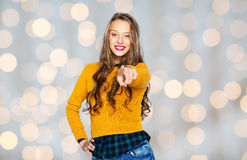 Happy young woman or teen pointing finger on you Royalty Free Stock Images