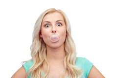 Happy young woman or teenage girl chewing gum Stock Images