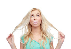 Happy young woman or teenage girl chewing gum Royalty Free Stock Image