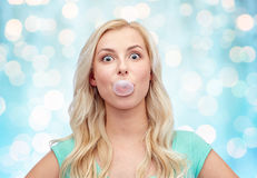 Happy young woman or teenage girl chewing gum Royalty Free Stock Images