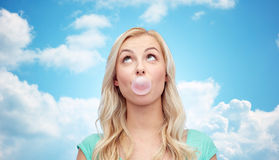 Happy young woman or teenage girl chewing gum Stock Image