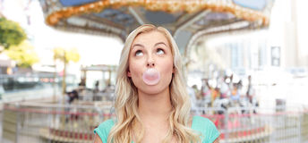 Happy young woman or teenage girl chewing gum Royalty Free Stock Photo