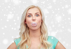 Happy young woman or teenage girl chewing gum Stock Photo