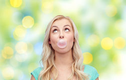 Happy young woman or teenage girl chewing gum Royalty Free Stock Photos
