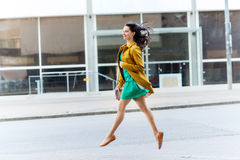 Happy young woman or teenage girl on city street Stock Photo