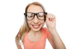 Happy young woman or teenage girl in eyeglasses Royalty Free Stock Photography
