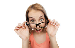 Happy young woman or teenage girl in eyeglasses Stock Photo