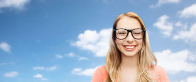 Happy young woman or teenage girl in eyeglasses stock images