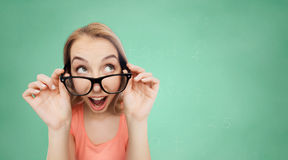 Happy young woman or teenage girl in eyeglasses Royalty Free Stock Image