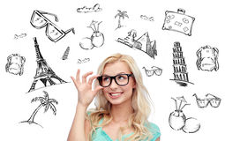 Happy young woman or teenage girl in glasses. People, tourism, vacation and summer holidays concept - happy smiling young woman or teenage girl glasses over Royalty Free Stock Images