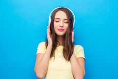 Happy young woman or teenage girl with headphones stock photo