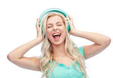Happy young woman or teenage girl with headphones Stock Images