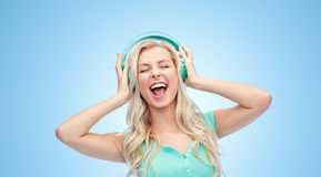 Happy young woman or teenage girl with headphones Stock Photos