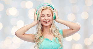 Happy young woman or teenage girl with headphones Royalty Free Stock Photos