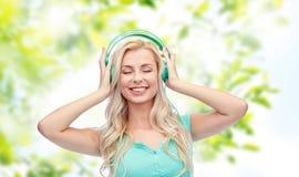 Happy young woman or teenage girl with headphones Stock Image