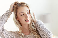 Happy young woman or teenage girl at home Stock Photo