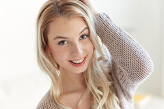 Happy young woman or teenage girl at home Stock Image