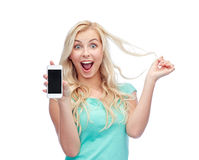 Happy young woman or teenage girl with smartphone Royalty Free Stock Image