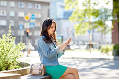 Happy young woman or teenage girl with smartphone Stock Photography