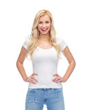 Happy young woman or teenage girl in white t-shirt royalty free stock photography