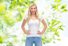 Happy young woman or teenage girl in white t-shirt Royalty Free Stock Photo