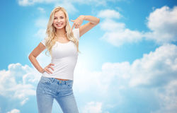 Happy young woman or teenage girl in white t-shirt Royalty Free Stock Images