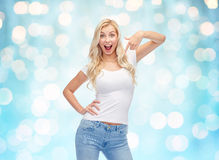 Happy young woman or teenage girl in white t-shirt Stock Photo