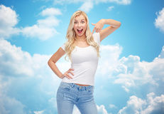 Happy young woman or teenage girl in white t-shirt Stock Photos