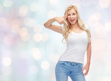 Happy young woman or teenage girl in white t-shirt Stock Image
