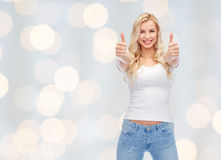 Happy young woman or teenage girl in white t-shirt. Emotions, expressions, advertisement and people concept - happy smiling young woman or teenage girl in white stock photography