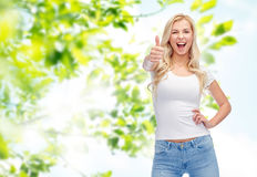 Happy young woman or teenage girl in white t-shirt Stock Images