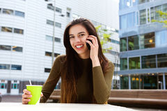 Happy young woman on telephone call outside Stock Image