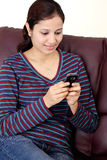 Happy Young woman text messaging Royalty Free Stock Images