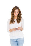 Happy young woman text messaging on mobile phone Royalty Free Stock Photography