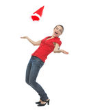 Happy young woman throwing Santa hat Royalty Free Stock Images