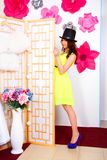 Happy young woman in a top hat Royalty Free Stock Image