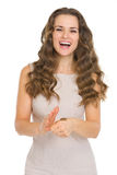 Happy young woman tossing coin Stock Photo