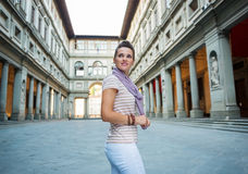 Happy young woman tourist having a walk tour in Florence, Italy. Be inspired by Uffizi Gallery. Happy young woman tourist having a walk tour in Florence, Italy stock photos