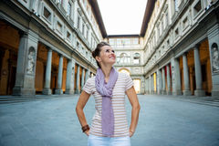 Happy young woman tourist having a walk tour in Florence, Italy. Be inspired by Uffizi Gallery. Happy young woman tourist having a walk tour in Florence, Italy stock photo