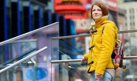 Happy young woman tourist sightseeing at Times Square in New York City. Female traveler enjoying view of downtown Manhattan. Travelling in USA royalty free stock images