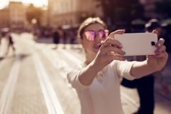 Happy young woman tourist takes selfie in old city. Summer travel. Vacation and holidays concept stock photos