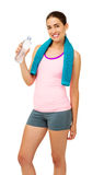 Happy Young Woman With Towel Drinking Water Stock Photography