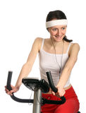 Happy young woman on a training bicycle Stock Image