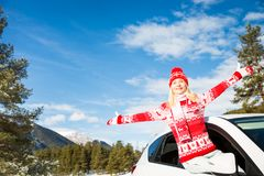 Happy woman travel by car in winter Royalty Free Stock Images