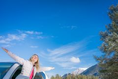 Happy woman travel by car in winter Royalty Free Stock Photography