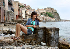 Happy young woman in travel Stock Photo