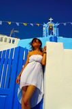 Happy young woman in a travel. Santorini Royalty Free Stock Images